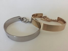 2 Armreifen in silber und gold