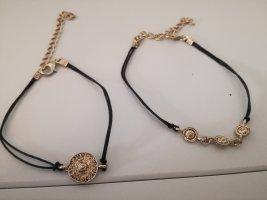 2 dünne Armketten mit bronzefarbenen Kreisen