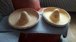 Chapeau de paille orange doré