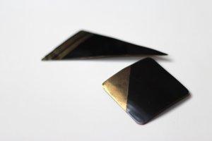 80erJahre Anstecker-Set, Blech, schwarz/gold