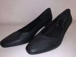 Zapatos de tacón con barra en T negro