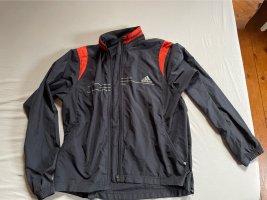 Adidas Giacca sport blu scuro-rosso
