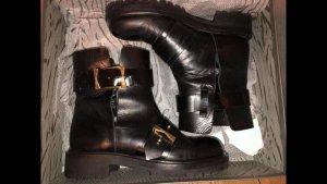 Alexander McQueen Botas de tobillo negro-color oro Cuero