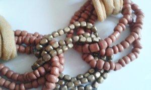 Armband aus Stoff und Perlen von Promod