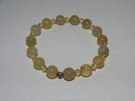 Brazalete de perlas color oro vidrio
