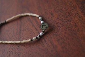 Armband von Konplott mit Waage Symbol