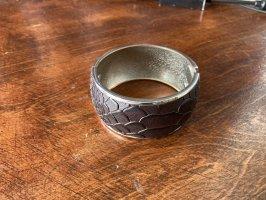 Mouwband donkerbruin-zilver