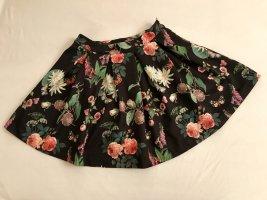 Ausgestellter, kurzer Faltenrock mit Blumenmotiven