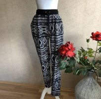 Pantalone peg-top nero-bianco