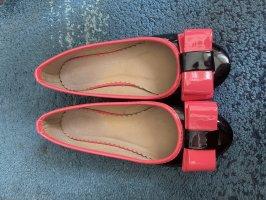 Bailarinas de charol con tacón negro-rosa