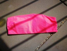 Top z dekoltem typu bandeau różowy