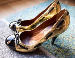 BCBG MaxAzria Leder Echtleder Pumps High Heels Steppung Designer gold schwarz Gr. 38,5
