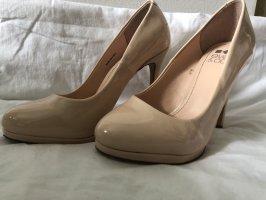 Beige high heels