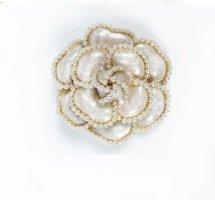 Broche color oro-blanco puro metal