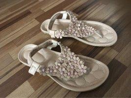 Sandalo toe-post rosa pallido