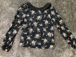 Bluse mit Blumenmuster und schwarzem Kragen
