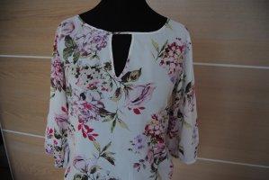 Bluse mit V-Ausschnitt und Steg mit Blüten