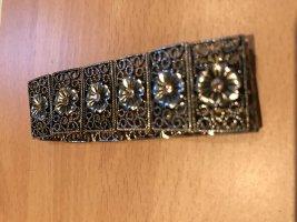 Gouden armband brons