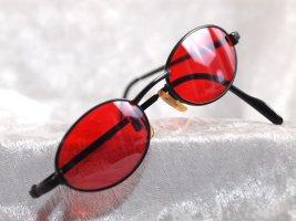 Brille mit rote Gläser