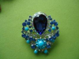 Broche azul neón