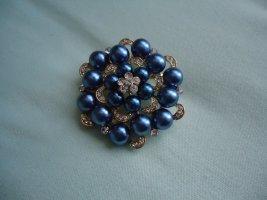 Broche azul