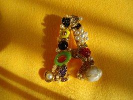 Broche multicolore