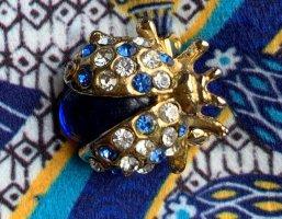 Broche doré-bleu