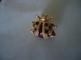 Brooch purple