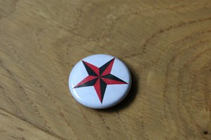 Button multicolored synthetic material