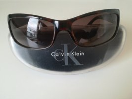 Calvin Klein Oval Sunglasses brown