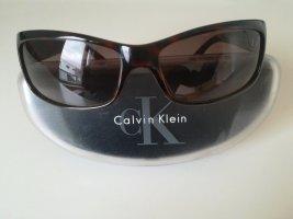 Calvin Klein Occhiale da sole ovale marrone