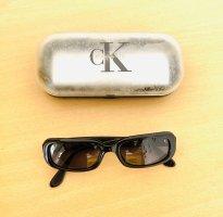 Calvin Klein Lunettes de soleil ovales noir