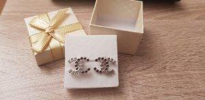 Chanel Boucles d'oreilles en argent noir-argenté