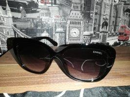 Chanel Ovale zonnebril zwart-goud