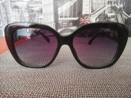 Chanel Gafas de sol ovaladas negro-color oro