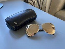 Chanel Gafas color oro