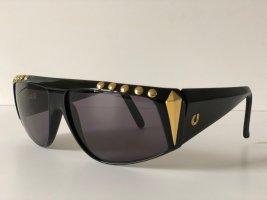 Charles Jourdan Ovale zonnebril goud-zwart