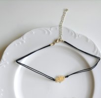 Collana nero-oro