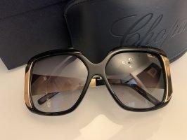 Chopard Lunettes de soleil ovales noir-doré