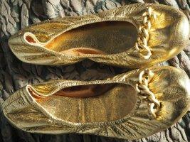 Closed Bailarinas plegables color oro Cuero