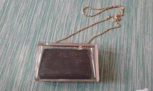 Clutch schwarz/gold/transparent Asos