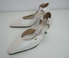 Zapatos de tacón con barra en T crema Cuero