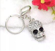 Cooler Schlüssel-/Taschenanhänger Totenkopf Torro Schädel ist aus Metall, Strass, silbrig NEU