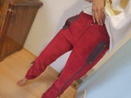 Pantalon en velours côtelé rouge brique