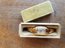 Fermoir de montre doré
