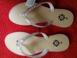 Sandały japonki z rzemykami kremowy