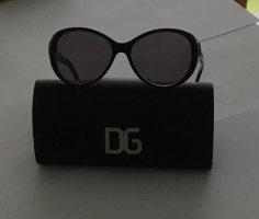 Dolce & Gabbana Ovale zonnebril zwart-stoffig roze