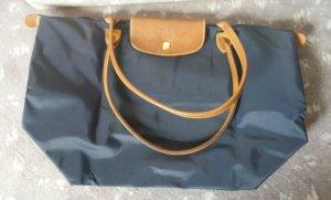 Dunkelblaue Longchamp le pliage Tasche