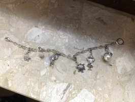 Armbandje met bedels zilver