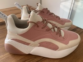Stella McCartney Sneaker stringata bianco-rosa pallido Pelle